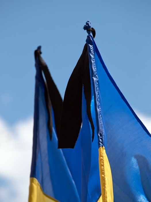 Mourning ribbon on Ukrainian flags