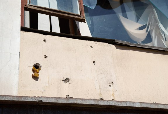 Bullet holes on the outside wall of Mariupol City Hall