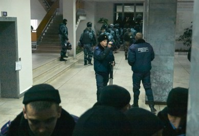 The riot police leave the building