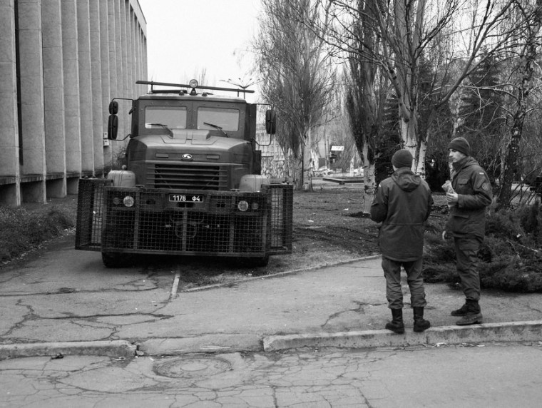 Armoured vehicle and National Guard of the Ukraine soldiers behind the Kryvyi Rih City Hall building