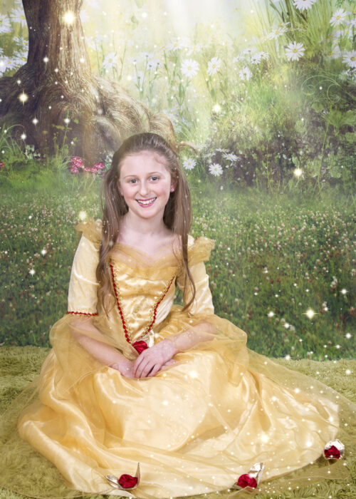girl in gold dress and red roses dressed as a princess