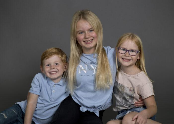 children sibling portrait on grey background taken in Hull