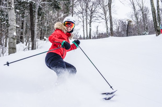 Our editor, Jenna Bostock, kicks up some snow on some seriously fresh groomers.