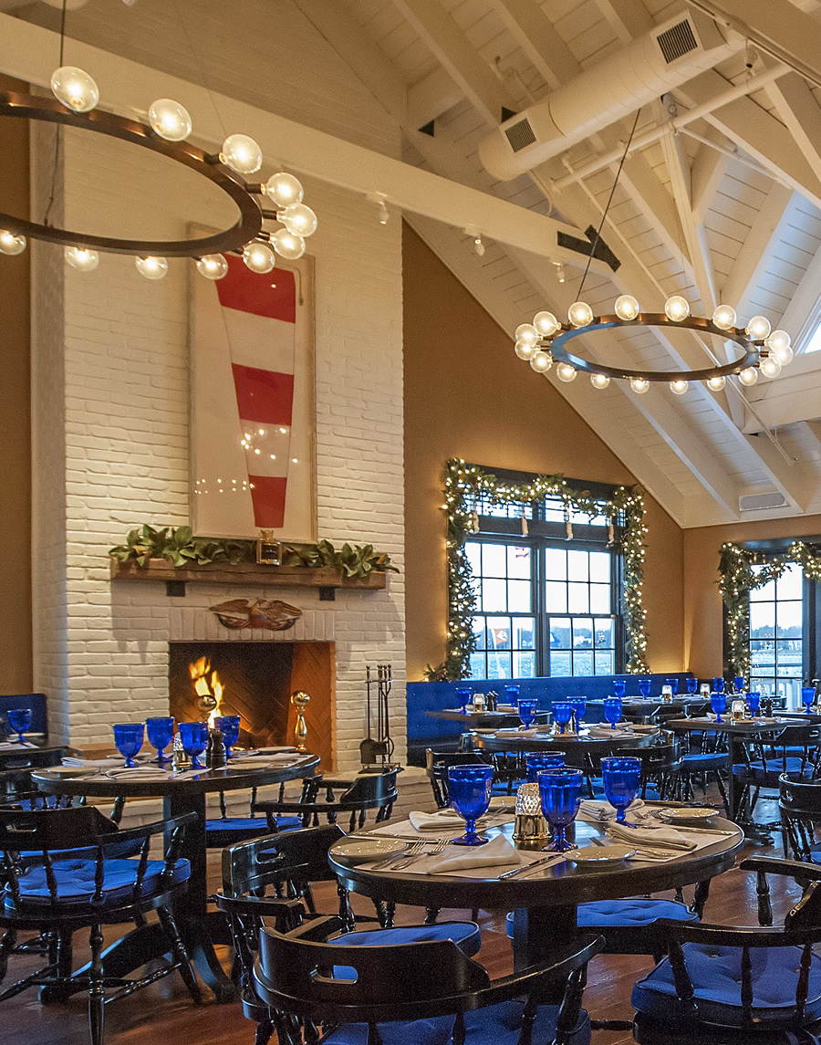 The restaurant at Baron's Cove draws hungry patrons by the fire under vaulted ceilings and chandeliers.