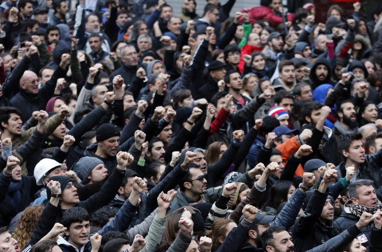 Anti-government protesters shout slogans during a demonstration in Istanbul March 12, 2014. Turkish Prime Minister Tayyip Erdogan criticised protesters who took to the streets of cities across the country in their hundreds of thousands on Wednesday after the funeral of a 15-year-old boy wounded in anti-government clashes last summer.   REUTERS/Murad Sezer (TURKEY  - Tags: POLITICS CIVIL UNREST)   - RTR3GS33