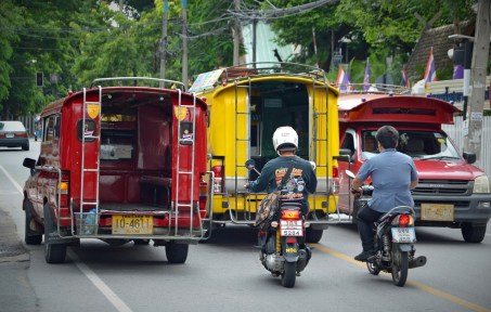 Red and yellow songthaews in Chiang Mai, Thailand.