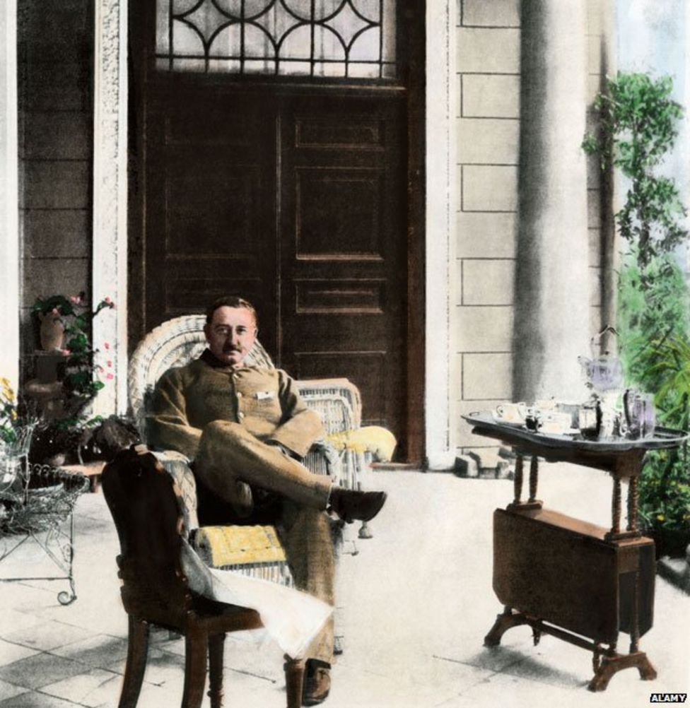 Cecil Rhodes seated on a porch