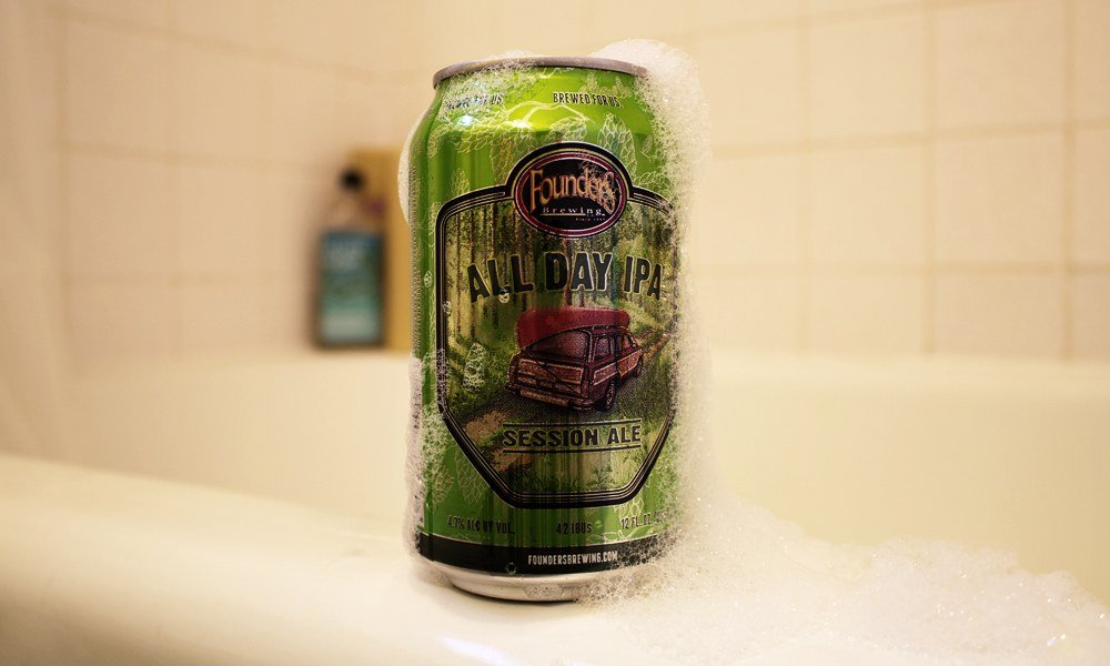 soapy beer can on bathtub edge