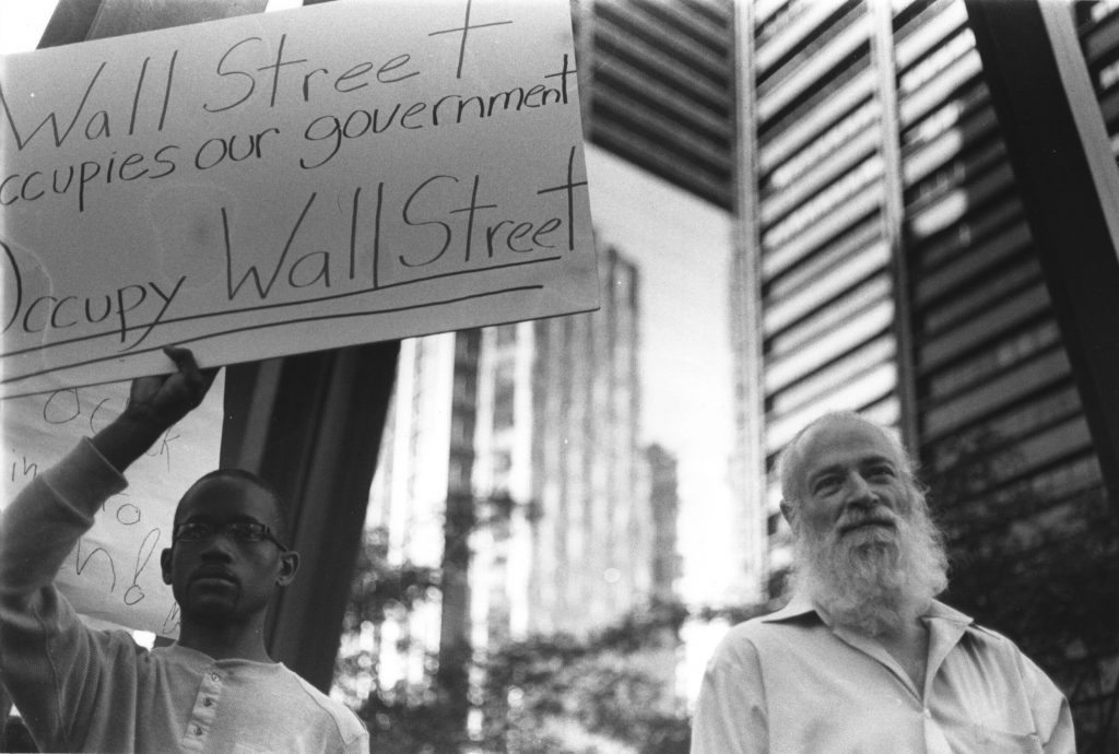 wall street occupies our government sign