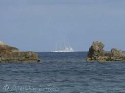 Sailing boat on horizon