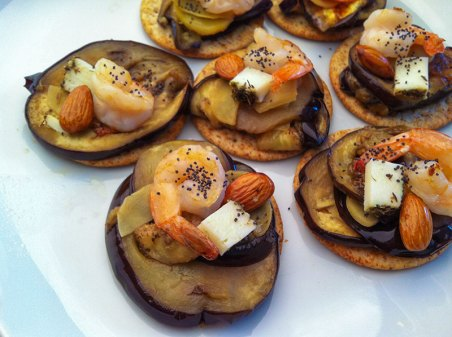Aubergine, prawns, cheese and almond on wheat cracker