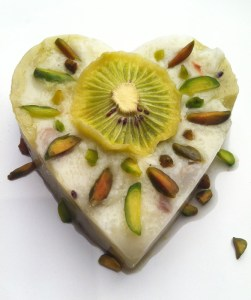 Khir (rice pudding) with dehydrated kiwi and pistachio.
