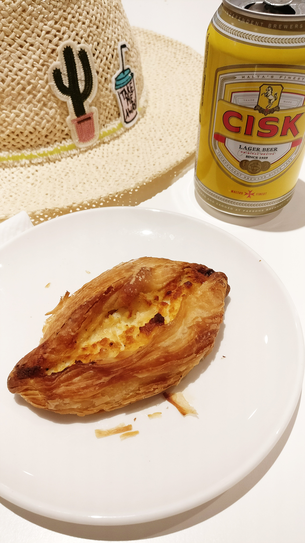 About Malta - Eating pastizzi and drinking Cisk