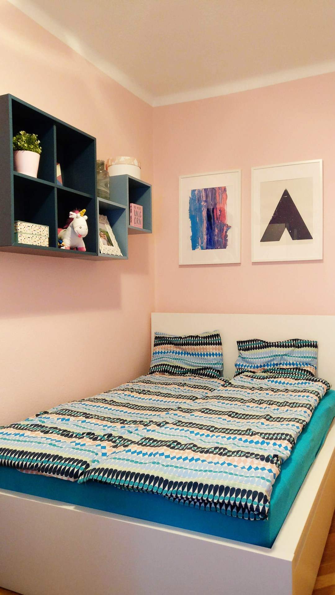 Pale pink bedroom with turquoise and blue - Warm up your home with pink wall colour | Aliz's Wonderland