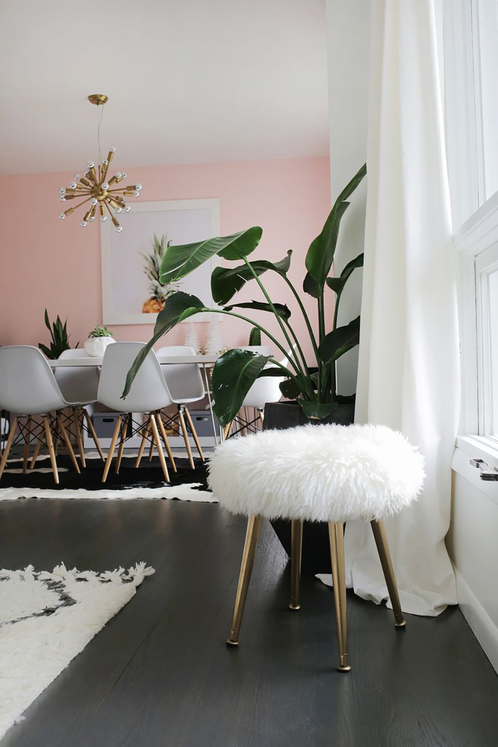 Pale pink living room with furry stool by a beautiful mess - Warm up your home with pink wall colour | Aliz's Wonderland