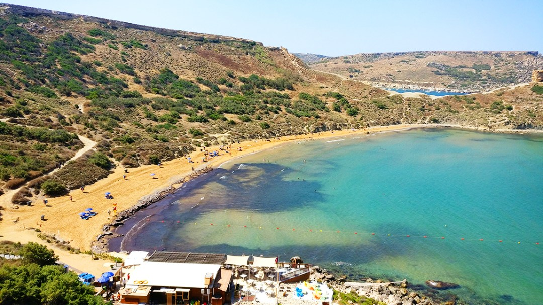 Ghajn Tuffieha bay with reddish sand - Best beaches in Malta | Aliz's Wonderland