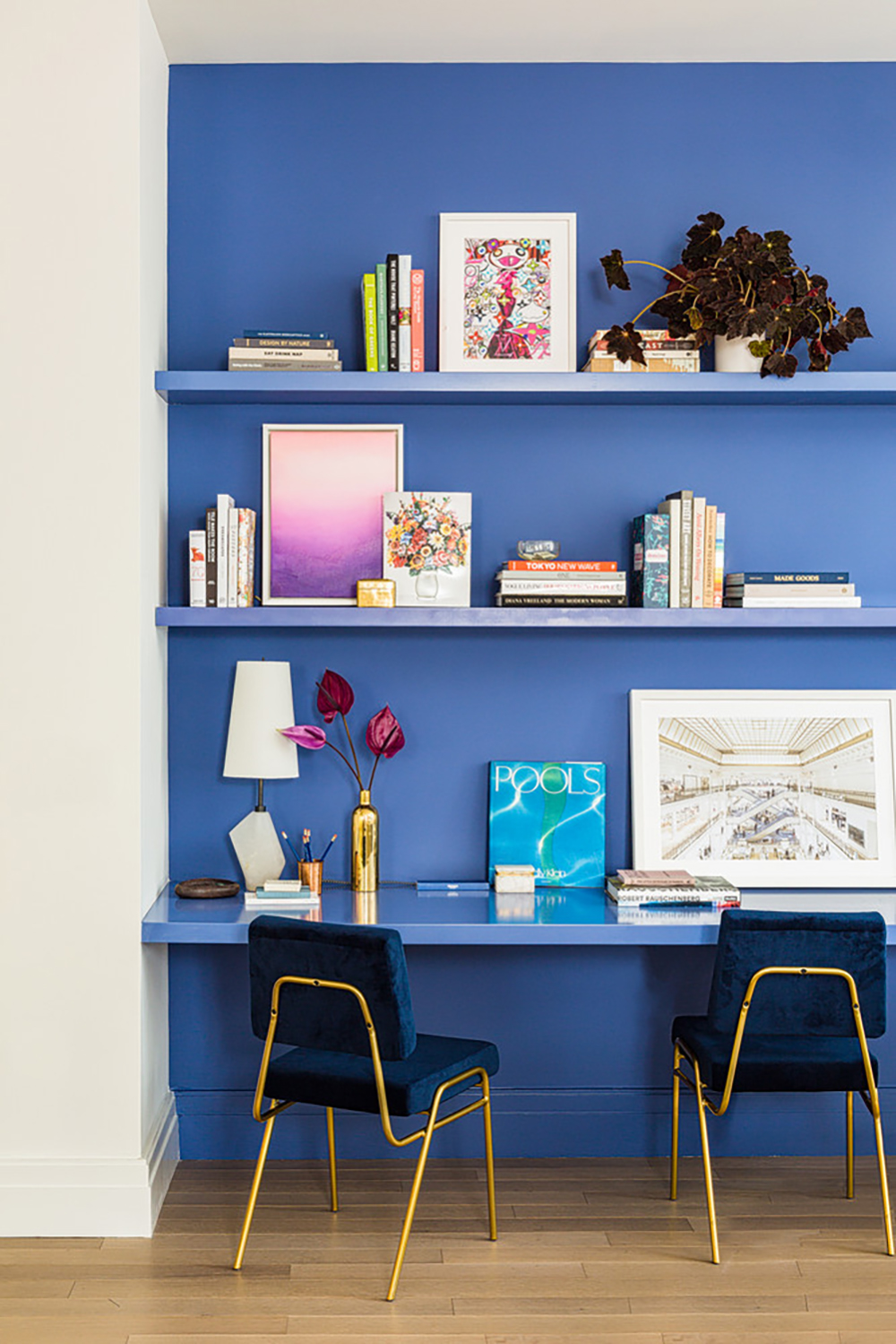 Vivid blue wall is very inspiring in this office with colourful books and accessories - 35 ideas for blue wall colour in home decoration | Aliz's Wonderland