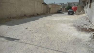"""Photo of أهالي أحياء في حمص يتخفون قدوم الشتاء .. """"شوارعنا محفرة و تفتقر للزفت"""""""