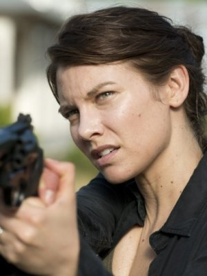 Maggie with a gun.