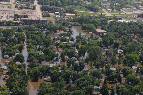 The Souris River, continues to flow over Minot, N.D. flood levees June 23, as the water begins to inundate residential neighborhoods. (DoD photo by Senior Master Sgt. David H. Lipp)