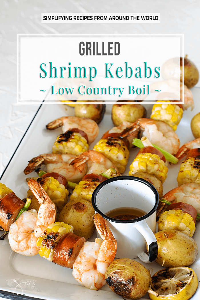 Grilled shrimp kebabs, aka low country boil, with potatoes, andouille sausage, and corn are easy and as good for a weeknight supper as they are for a date night or a holiday celebration. | allthatsjas.com | #shrimp #bbq #grilling #kebabs #kabobs #skewers #lowcountryboil #dinner #holidays #cookout #memorialday #recipes #quick #easy