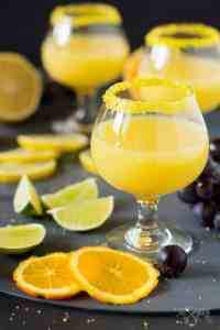 An alcoholic beverage made in one minute with orange, lemon, lime and vodka.