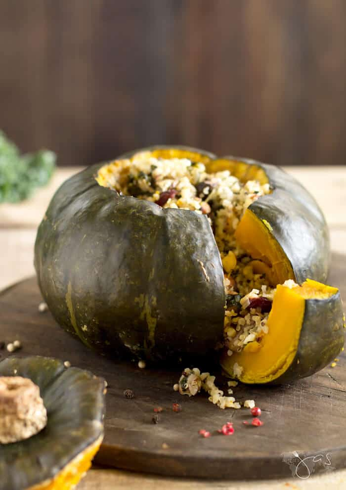 Baked buttercup squash stuffed with kale, quinoa, mushrooms, almonds, and cranberries.