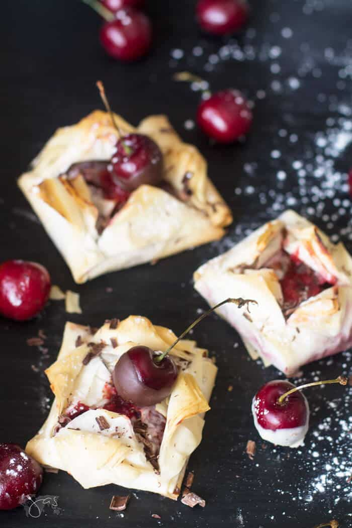 Delicate fillo blossoms with cherries and chocolate
