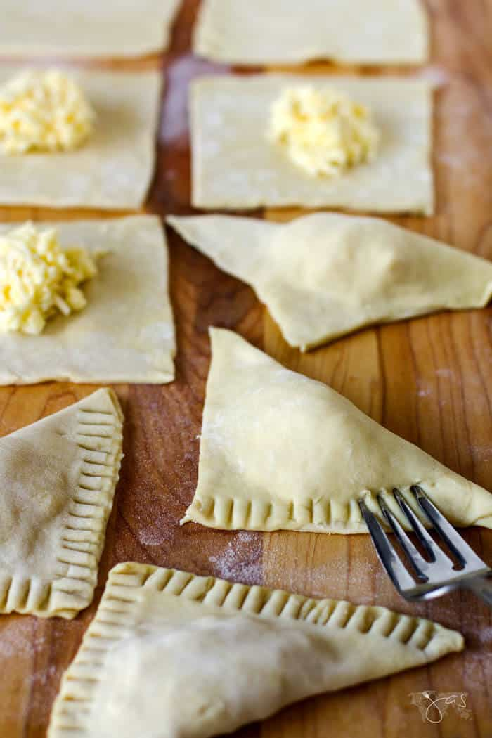 creating bourekas with puff pastry and cheese