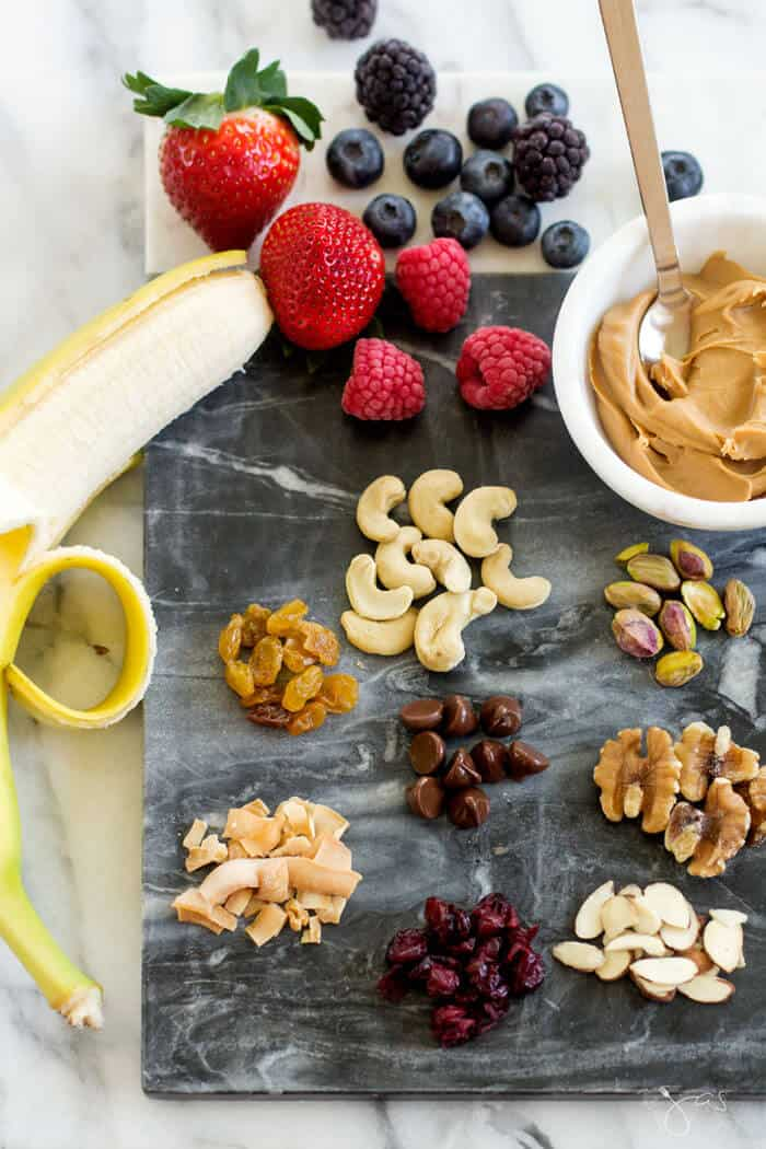 Ingredients for monkey breakfast bowl with fruit and nuts