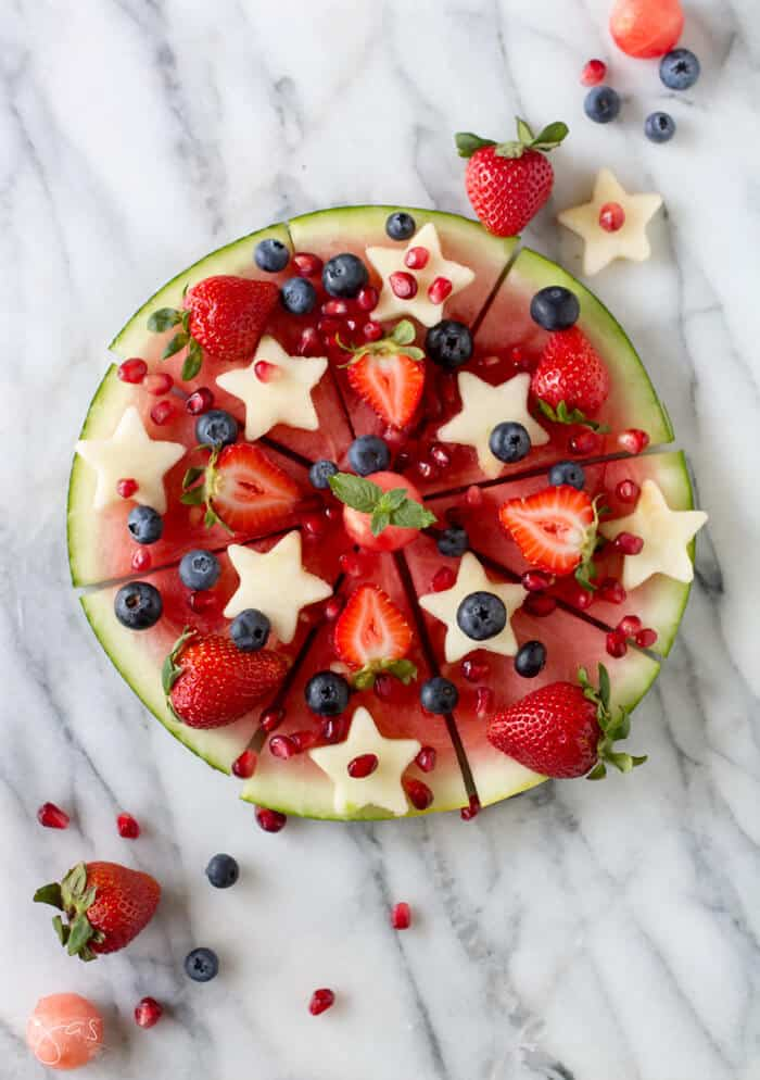 Infused watermelon pizza with mixed fruit.