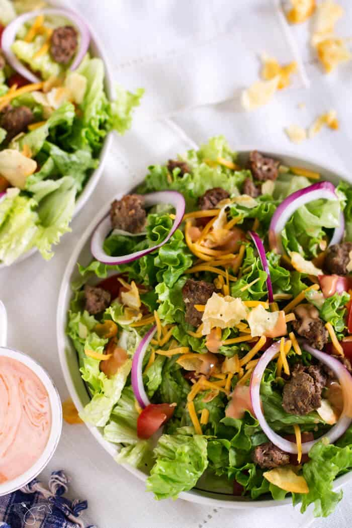 When you grill too many hamburgers, make this amazing salad the next day. Perfect way to use leftover burgers! #BBQ # salad #leftover #cheeseburger #glutenfree #quick #easy #recipeofthemonth #grilling