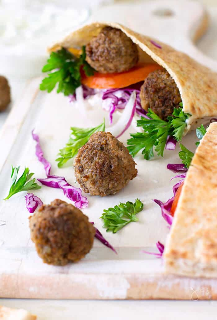 Greek lamb meatball pita sandwich is the perfect solution for a quick and satisfying dinner your family will love. | allthatsjas.com