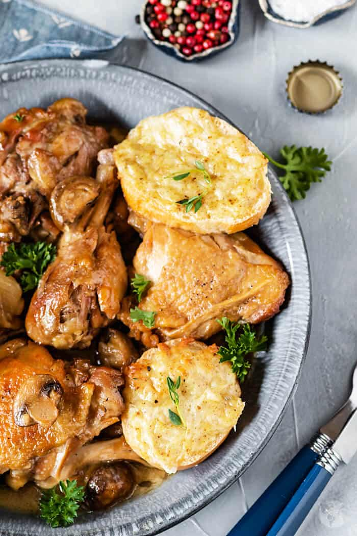 A flavor-packed dish of beer braised chicken with mushrooms and topped with cheesy Welsh rarebit toasties will not disappoint even the pickiest eater!