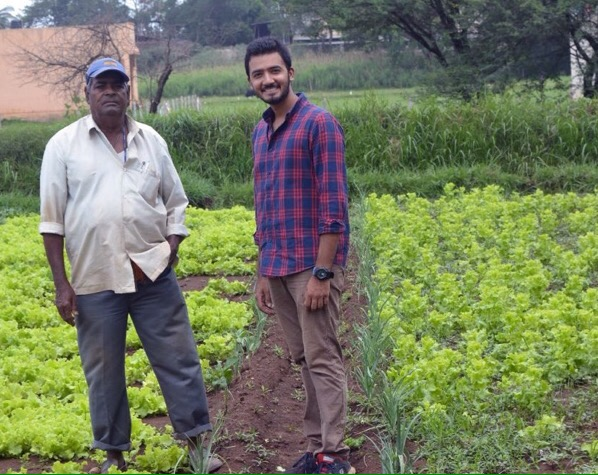 Kumail Barafwala on thr right along with a farmer