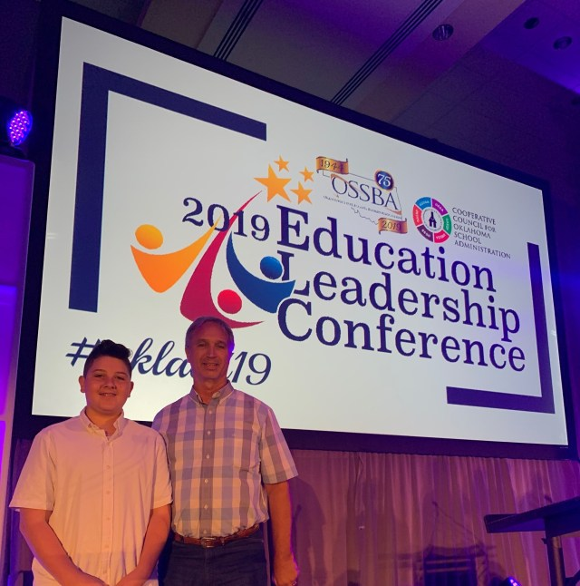 Ethan Munroe performs at 2019 educational leadership conference.