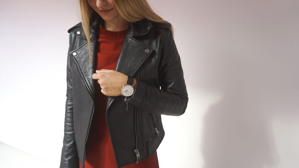 details photo of diesel leather jacket and daniel wellington rose gold watch