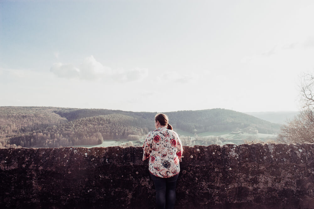 Woman in a floral top admiring the view from Breuberg castle