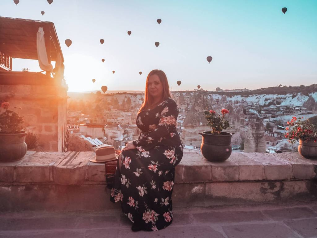 Woman in a floral dress watching the hot air ballons in Cappadocia.
