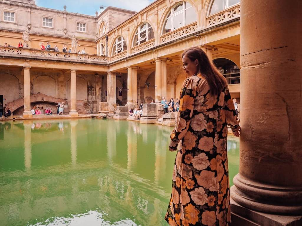 Woman in a floral dress at The Roman Baths in Bath city, one of the many things to do in Bath