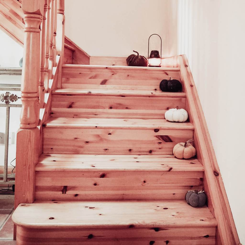 Pumpkins staggered down a staircase for fall decor