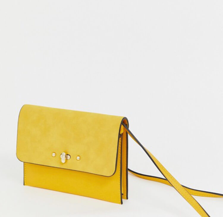 Accessorize yellow cross body bag.