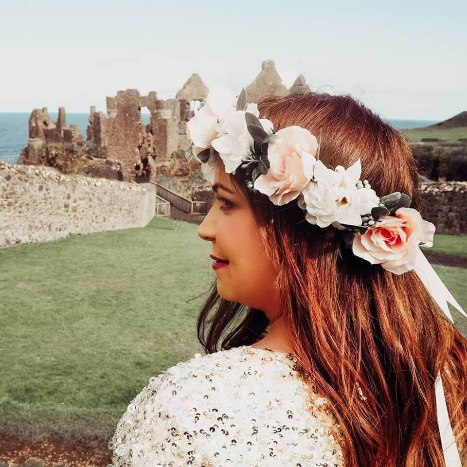 girl with flower crown looking at a castle