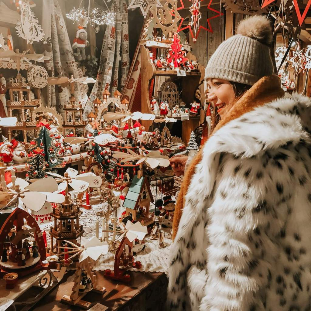 Woman shopping at the Christmas Markets in Colmar.