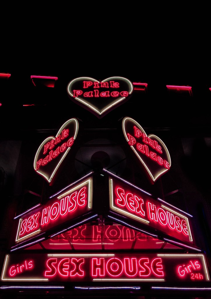 Neon signs at the Reeperbahn in Hamburg