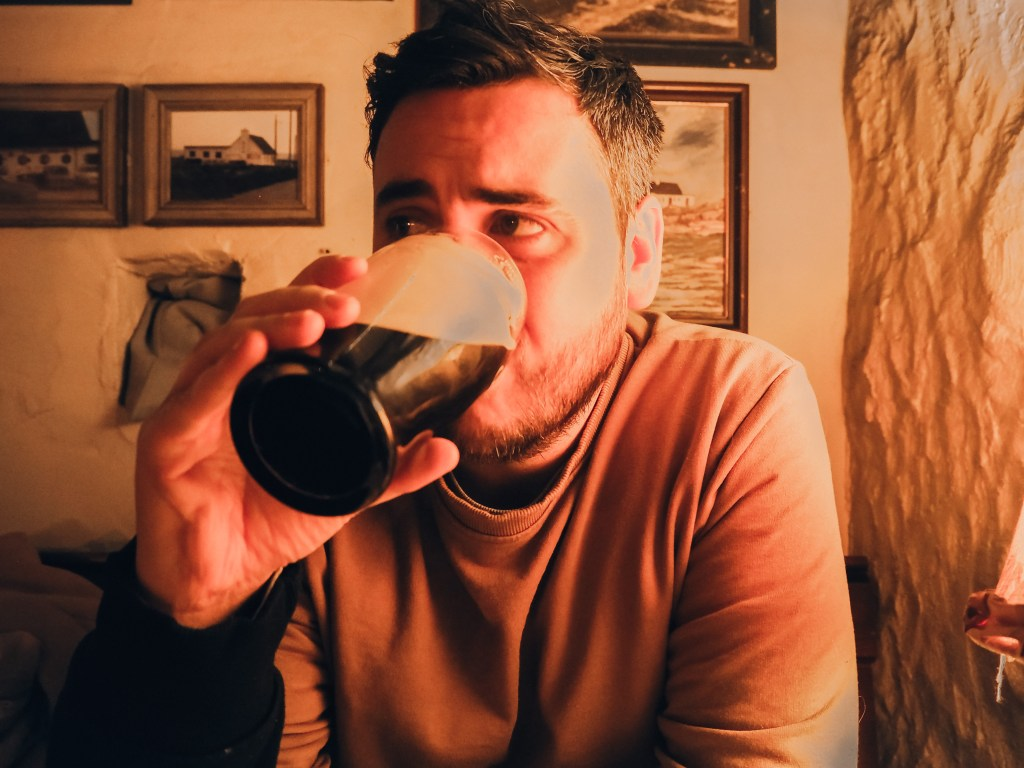 Man drinking a pint of Guinness in Ireland