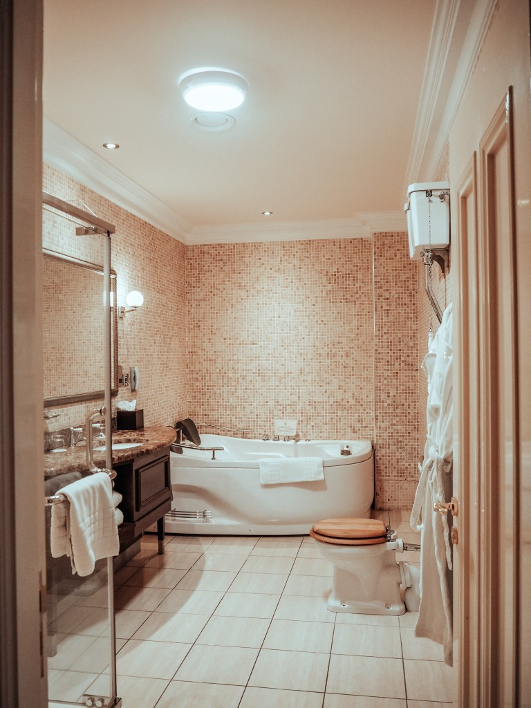 Bathroom of the Dovecote suite at Lough Erne Hotel with a double jacuzzi.