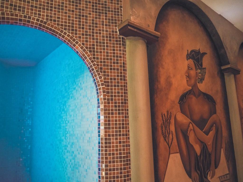 Wall mural painted beside mosaic tiles in the Thai spa of Lough Erne resort