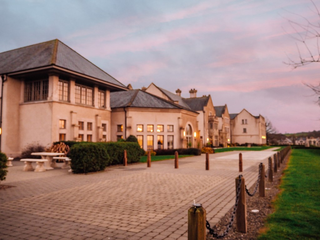 The buildings of Lough Erne Golf and Spa resort at sunset.