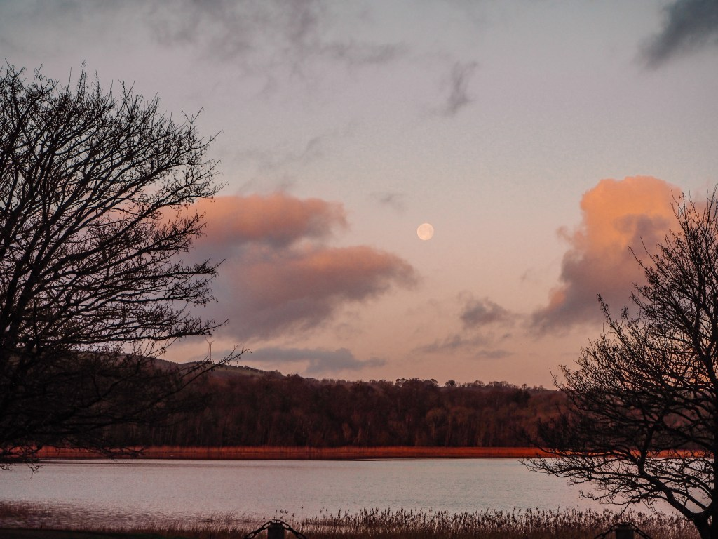 Early morning views over Castle Hume Lough with the moon still visible in the sky.